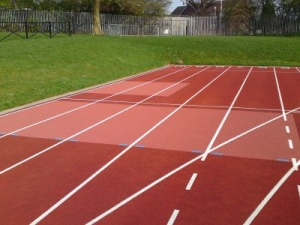 Athletic track surface repair