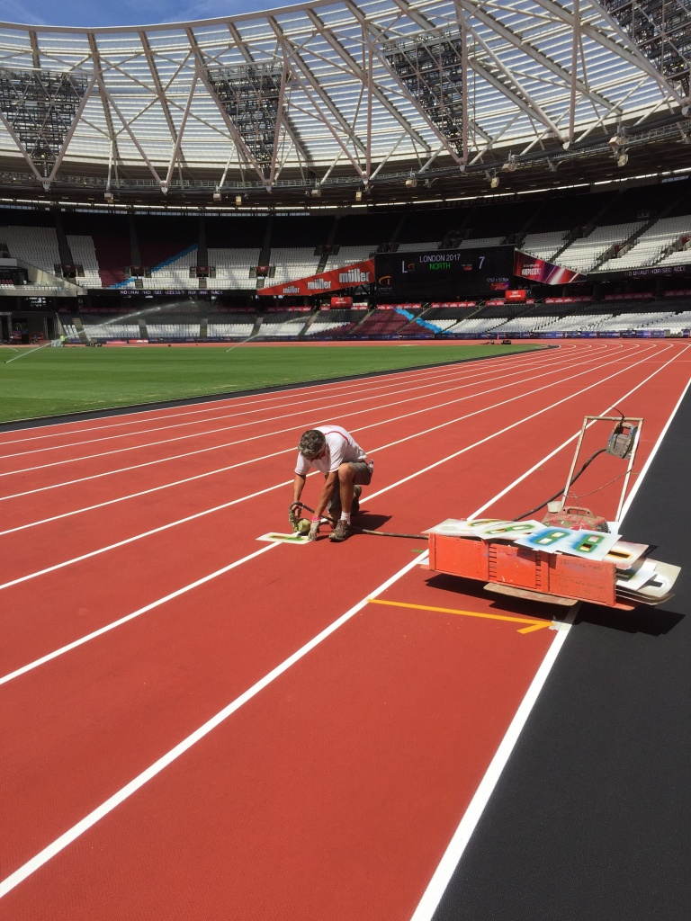 Marc spray painting hurdles