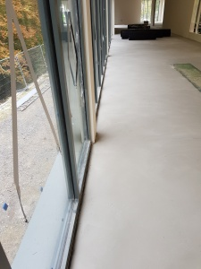 devon installation- concrete floor screaded to imporve levels.
